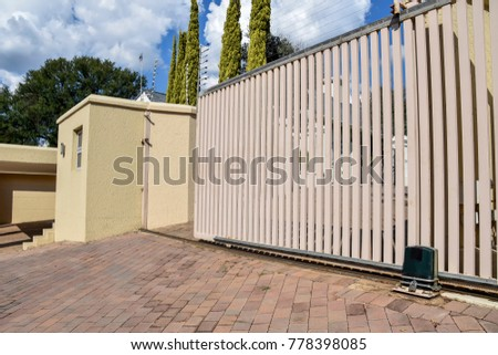 a typical electric fence and gate in an upscale residential area in pretoria south africa