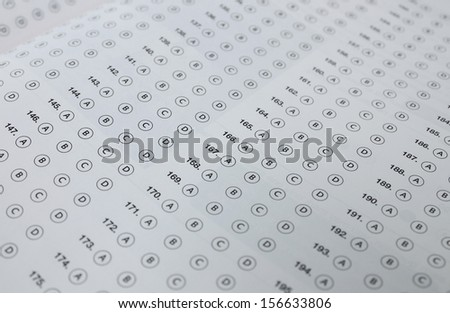 A typical multiple choice answer sheet. - stock photo