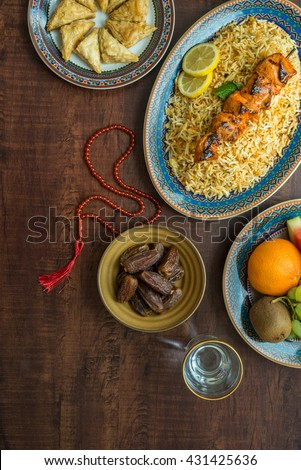 A typical spread of Iftar food dishes. A variety of food is consumed after sunset during Holy month of Ramadan. - stock photo