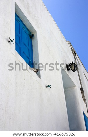 A typical white house in Mykonos, Greece with blue sky on the background - stock photo