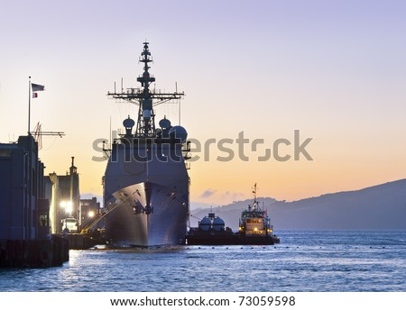 A U.S. Navy Cruiser at Port in San Francisco - stock photo