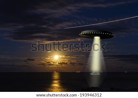 A UFO abducting a fishing boat at sea with a full moon in the background - stock photo