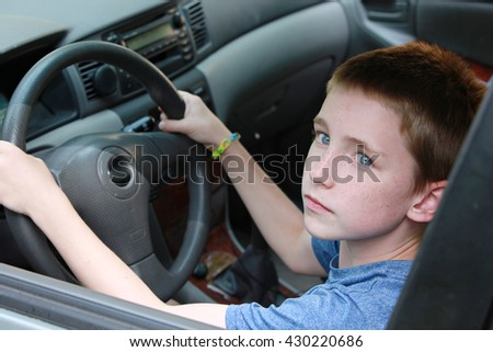 A under age kid driving a car