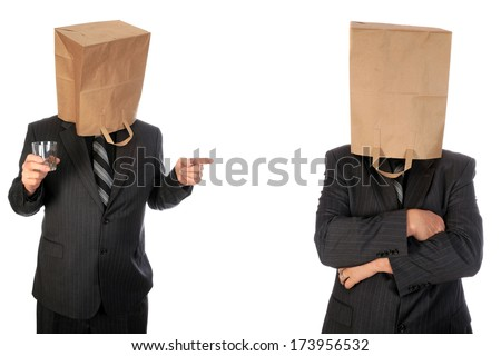 A unidentifiable business man in a grey pin stripe suit wears a paper grocery bag over his head. Isolated on white with room for your text. images are easily cropped out for use anywhere. - stock photo
