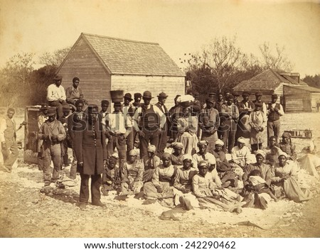 A Union soldier stands with African Americans on the plantation Thomas F. Drayton, Hilton Head Island, South Carolina, 1862. Photo by Henry P. Moore, May 1862. - stock photo