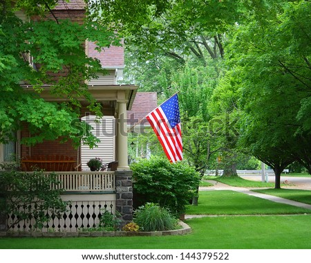 A United States Flag On An Old Porch - stock photo