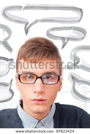 A university college student or casual good looking man wearing glasses portrait. Looking At camera. Blank balloon with his thoughts for your text and logo - stock photo