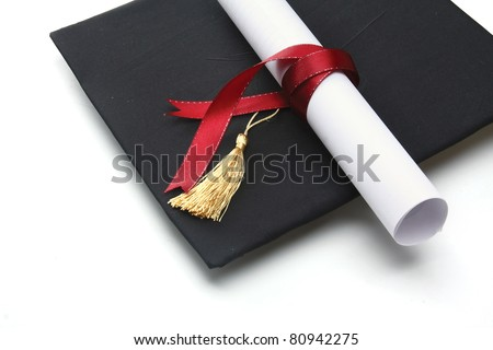 A university diploma with a red ribbon isolated on white - stock photo