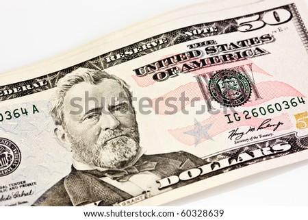 A US Fifty 50 Dollar Bill close up of Grant on a white background - stock photo