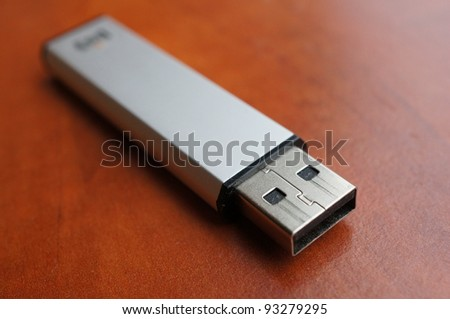A USB stick on a wooden background
