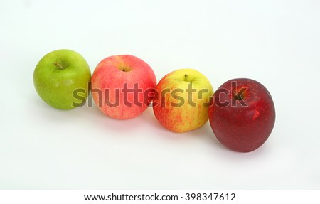 A variety of apples in a row