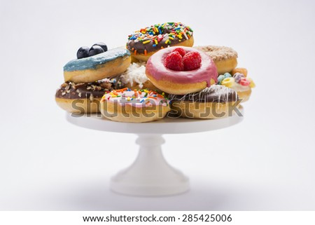 a variety of colorful fresh donuts isolated on white  - stock photo