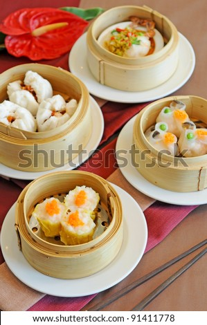 A variety of dim sum in bamboo steam - stock photo