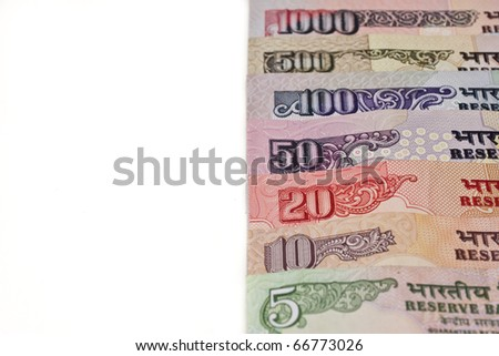A variety of Indian rupee notes isolated on a white background. - stock photo