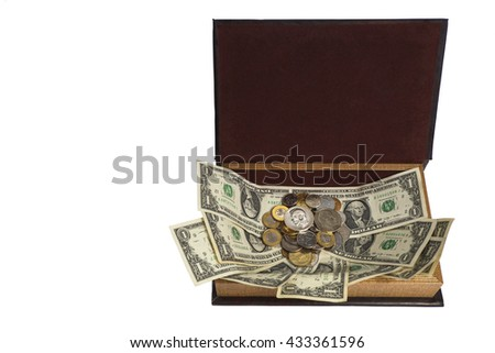 A variety of monetary denominations of coins on the paper in an open casket. - stock photo