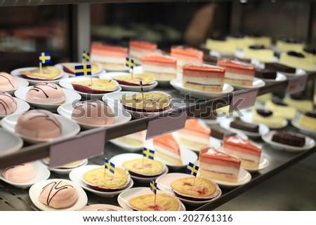 A variety of Swedish cakes on shelf  - stock photo
