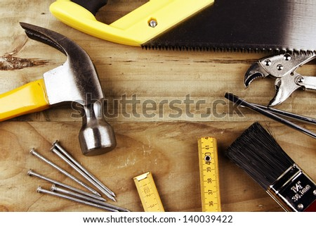 A variety of tools on wood - stock photo