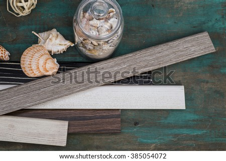 A variety of Wooden Skirting boards on old floor background - stock photo
