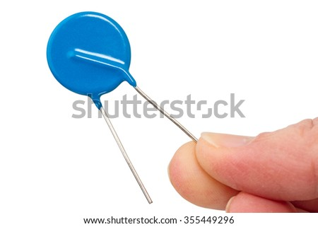 A varistor is an electronic component with an electrical resistance that varies with the applied voltage. - stock photo