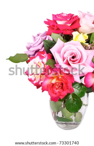 A vase of beautiful home grown roses, on a white vertical background with copy space - stock photo