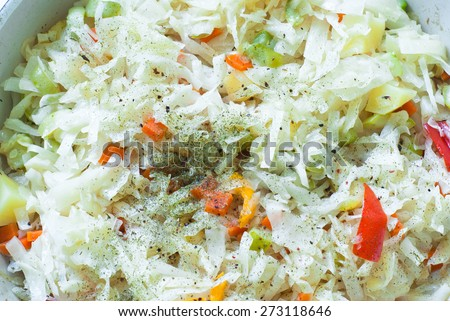a vegetable ragout of cabbage, carrots, potatoes, peppers and zucchini. Selective focus. - stock photo