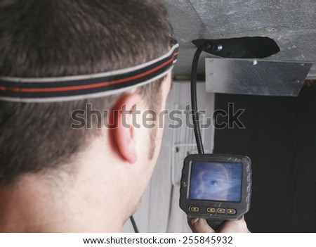 A ventilation cleaner man at work with tool - stock photo