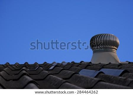 A ventilator against blue sky - stock photo