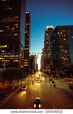 A vertical dusk shot of the Financial District of Los Angeles