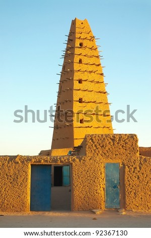 A vertical image of the front of the mud mosque in Agadez - stock photo