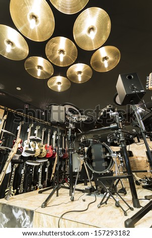A vertical low angle shot of a drum set in a musical instrument store - stock photo