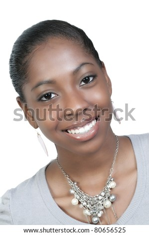A very beautiful African American black woman teenager with a big smile - stock photo