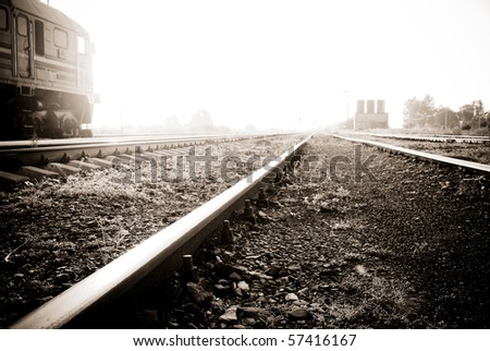 A very bright railway to heaven - sepia - stock photo