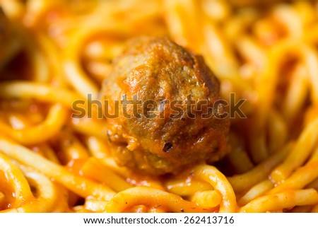 A very close view of a spaghetti and a single meatball. - stock photo