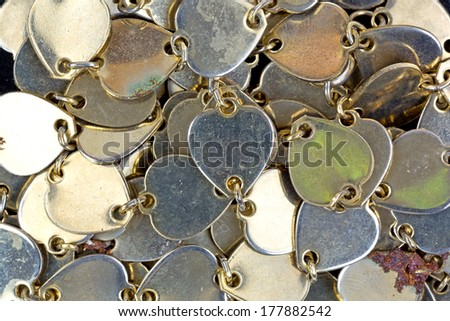A very close view of a vintage heart shaped necklace. - stock photo