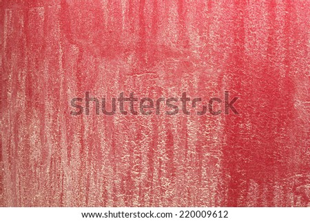 A very close view of an exceptionally dirty red car rear bumper. - stock photo