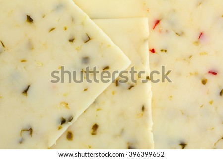 A very close view of pepper jack cheese.
