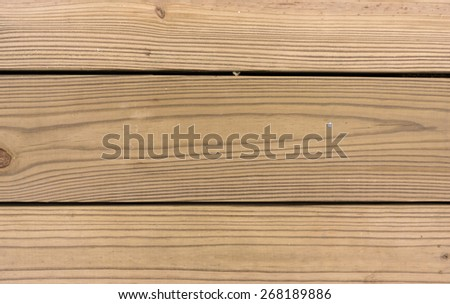 A very close view of pressure treated decking boards. - stock photo