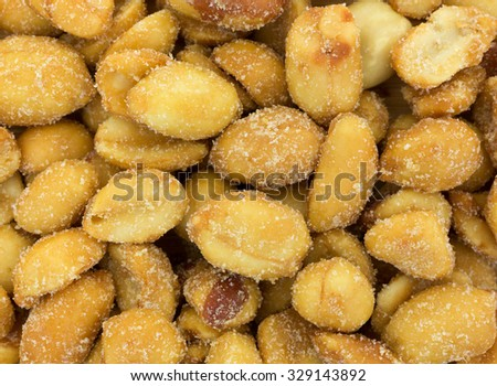 A very close view of salted caramel peanuts. - stock photo