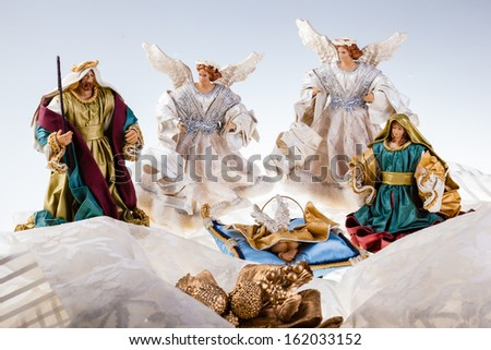 a very elegant crib with baby jesus, the virgin Mary, St. Joseph and two angels - stock photo