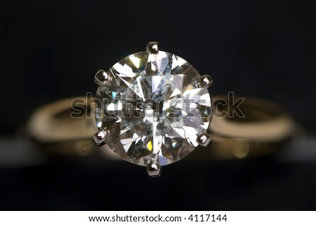 A very large diamond ring on a black background. - stock photo