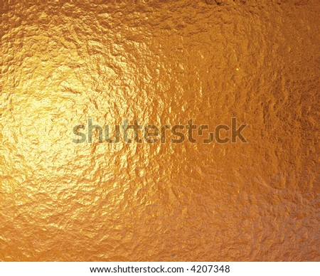 a very large sheet of fine crinkled gold aluminium foil - stock photo