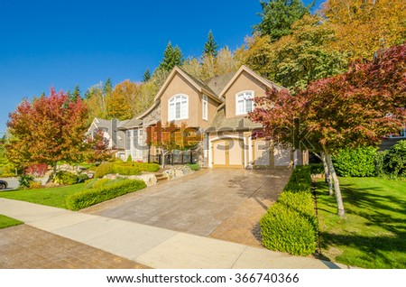 A very neat and colorful home with gorgeous outdoor landscape in suburbs of Vancouver, Canada - stock photo