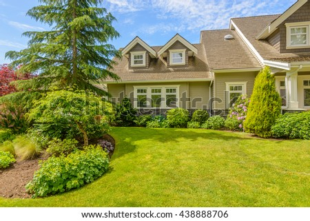 A very neat and colorful home with gorgeous outdoor landscape in suburbs of Vancouver, Canada. - stock photo