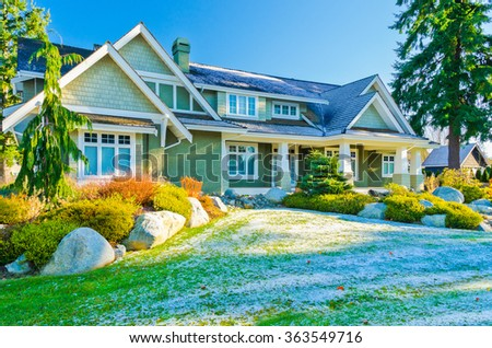 a very neat and tidy home with gorgeous outdoor landscape covered with snow patches at winter day in suburbs of Vancouver, Canada - stock photo