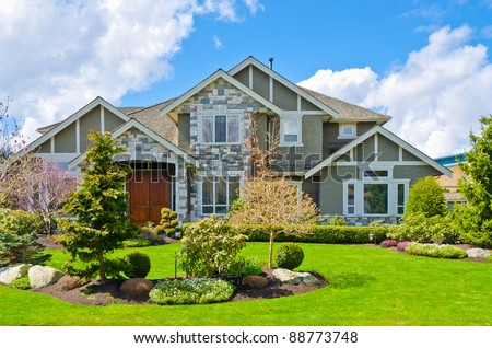 a very neat and tidy home with gorgeous outdoor landscape in suburbs of Vancouver, Canada - stock photo