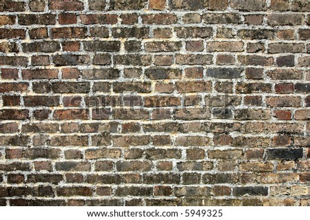 A very old brick wall close up background.