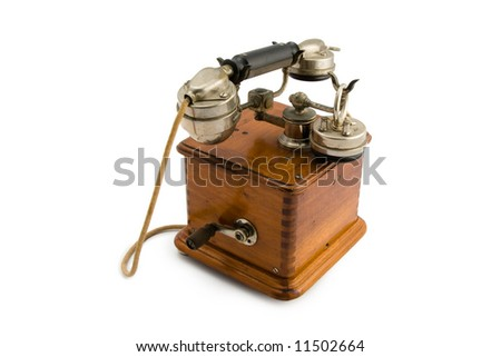 A very old phone from the 30's. Isolated on white with clipping path excluding drop shadow.