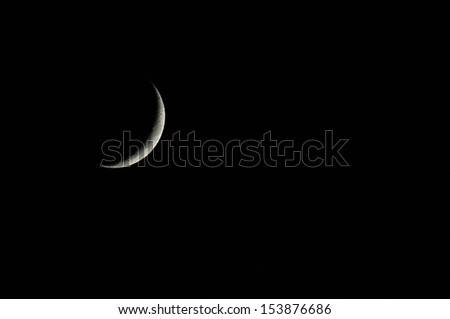 A Very Small Early Moon in the Deep of the Night - stock photo