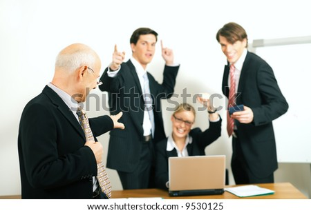 A very successful business team with a portrait of the team leader in foreground (selective focus only on the team leader!) - stock photo