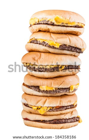 a very tall pile of cheesburgers isolated over a white background - stock photo